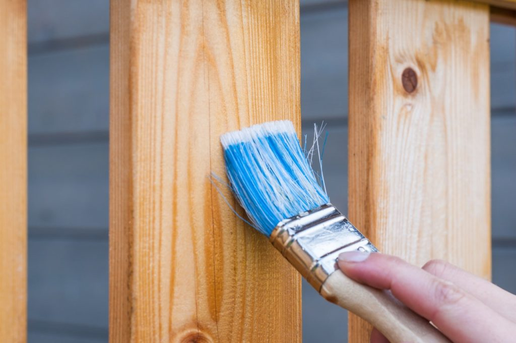 Paint brush painting on wood